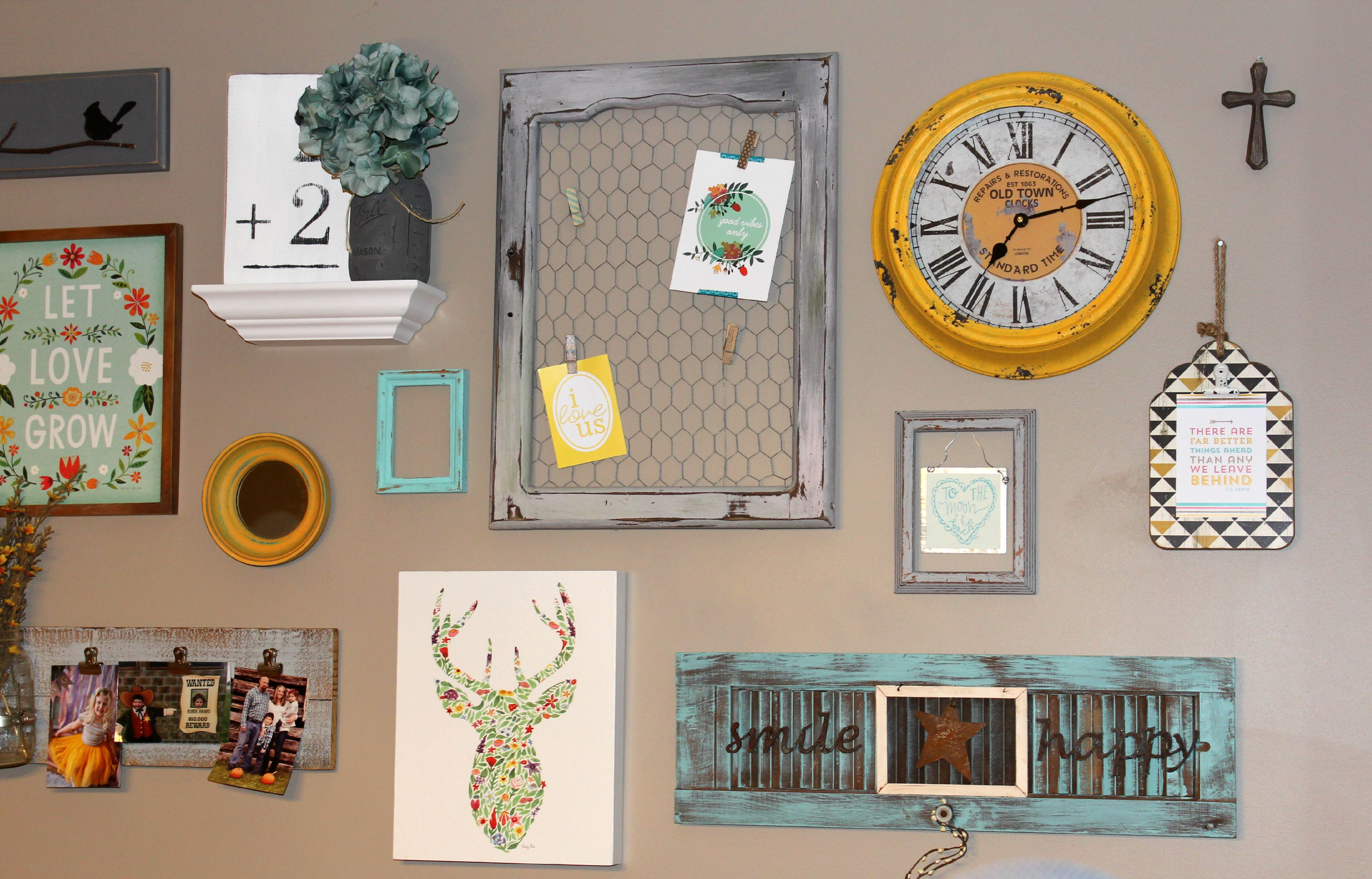 Rustic Wall Decor Gallery with a variety of interesting objects, art and picture frames.