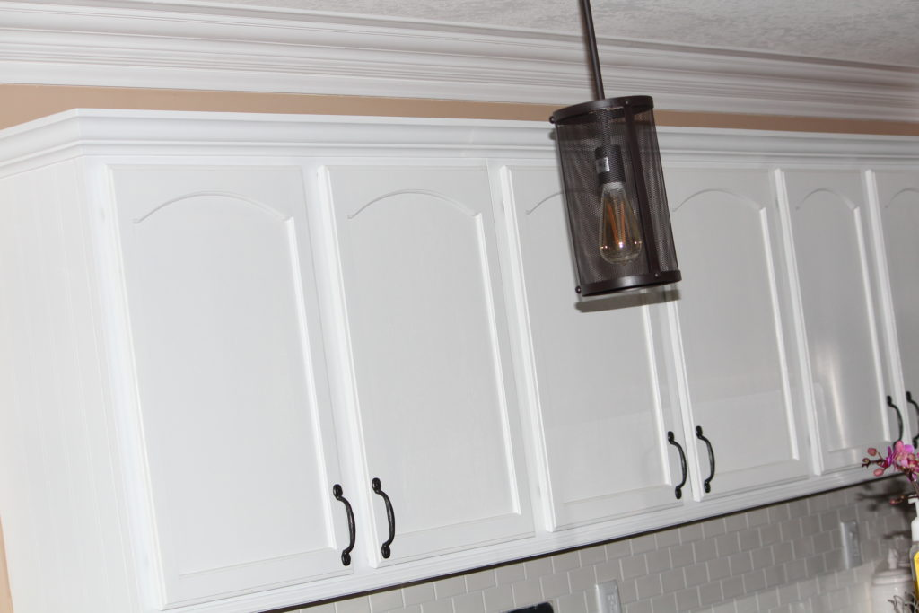 painting oak cabinets white our diy kitchen remodel painting your cabinets white 24514