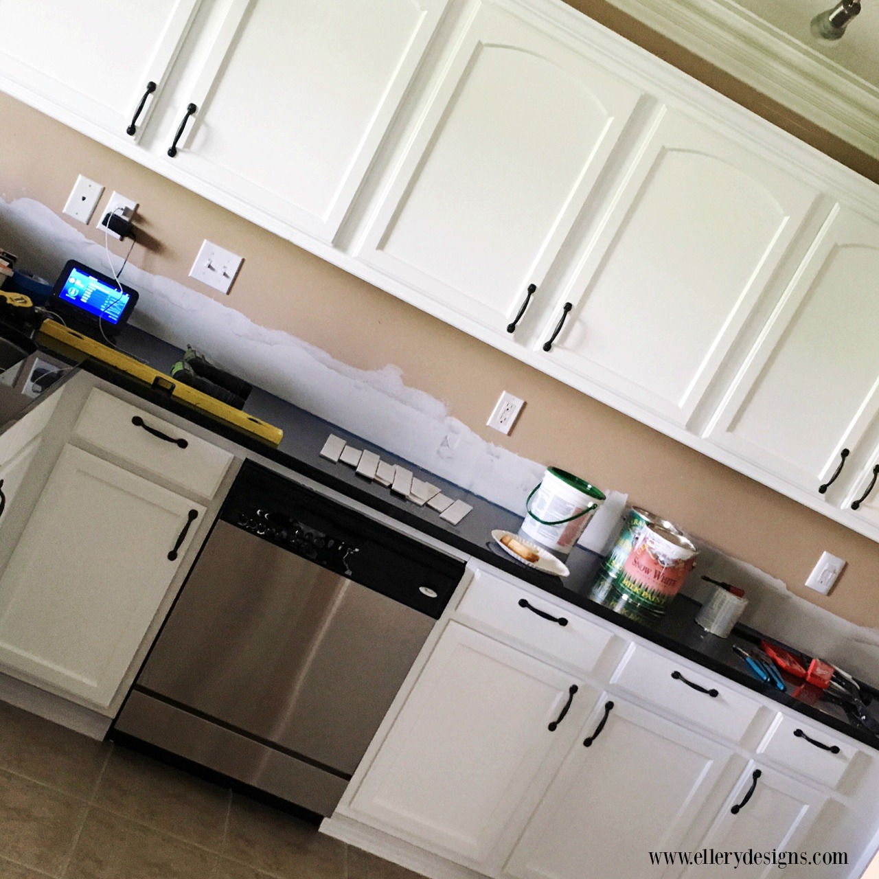 painting kitchen cabinets white diy our diy kitchen remodel painting your cabinets white 7343